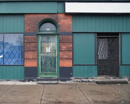 An old door and empty store front windows downtown in Buffalo, NY for an economic business development concept