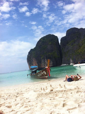 Women sunbathing and taking photo in Poda Island Thailand Stock Photo
