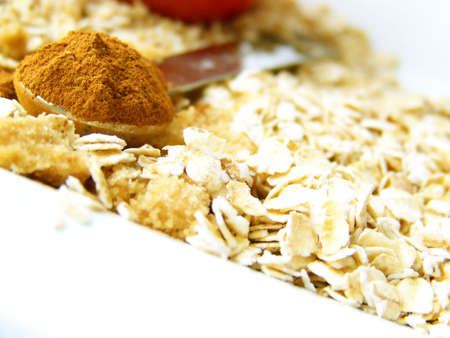 heaping: Image of a heaping spoonful of cinnamon, with brown sugar and oats.  Room for text or other material in bottom left of image.  Horizontal orientation. Stock Photo