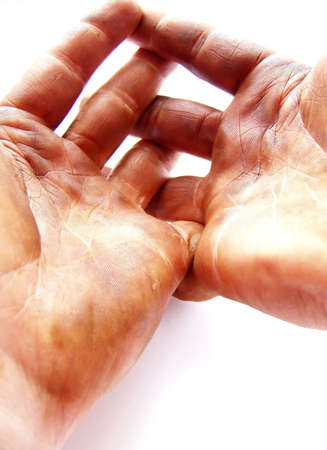 hand print: Image of two strong hands, darkened with grease, with fingers interlaced.  Background is white, and image has a vertical orientation. Stock Photo