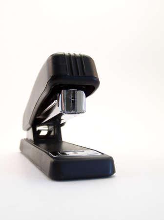 office stapler: Image of a black stapler on white background.  Vertical orientation. Stock Photo