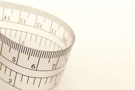 inches: Image of a transparent ruler, bending in and out of the frame. Stock Photo