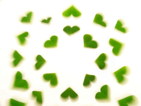 Image of a heart pattern created by clover leaves. 版權商用圖片