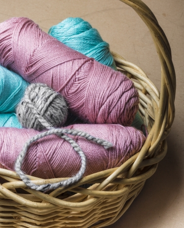 Pink Blue  Grey yarn in basket Imagens