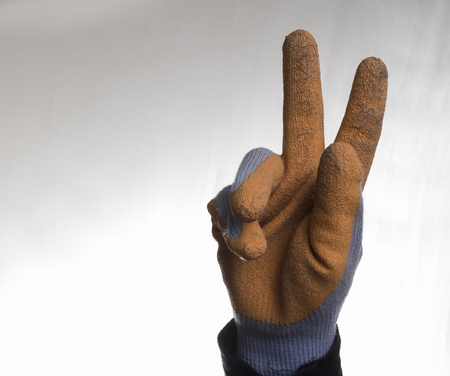 ornage: Isolated victory sign for a worker, ornage gloves