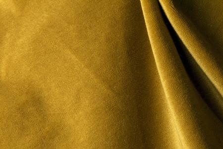Golden angorageit velours stof die lijkt op fluweel, gemengd met natuurlijke zijden draad. mohair textiel. kasjmier, fluweel suede en gemzen effect. voor de bekleding Stockfoto