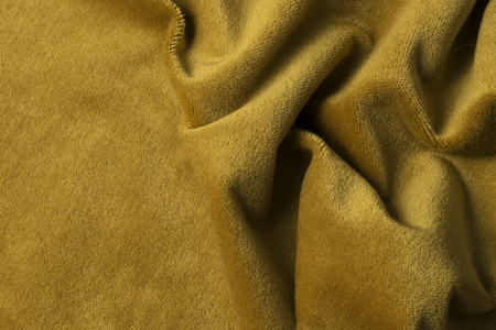 velours: Golden angora goat velours fabric resembling velvet, mixed with natural silk threads. mohair textile. cashmere, velvet suede and chamois effect. for upholstery