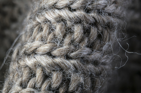 highly detailed needlework wool fabric, close up wool texture background.