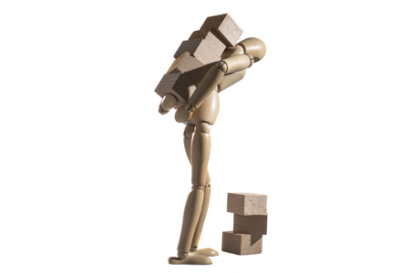 isolated wooden dummy carrying wooden blocks, heavy tasks, psychological concept. Stock Photo