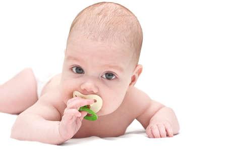 nurseries: Cute baby sucks a dummy