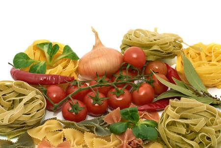 Italian pasta tagliatelle and farfalle with vegetables photo