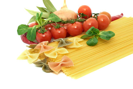 Italian pasta spagetti and farfalle with vegetables photo