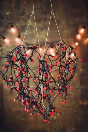 festoon: Wicker heart of red garlands lights