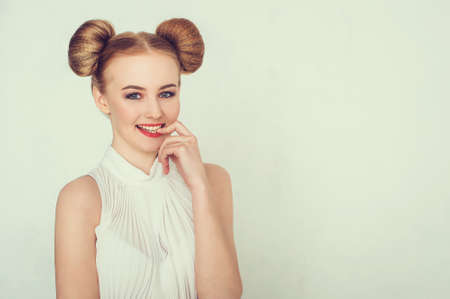 slander: Close-up portrait happy beautiful girl with funny hairstyle. Sly and scheming young woman face expression.