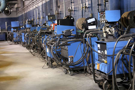 Row of welding machines in a shop