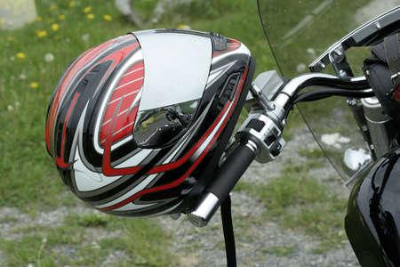Motorbike helmet on the handlebar