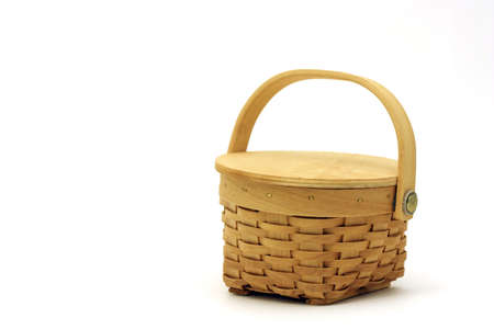 Small tan basket isolated on white photo