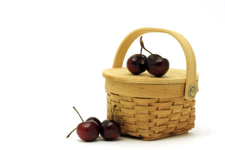 Basket full of cherries ready for picnic photo