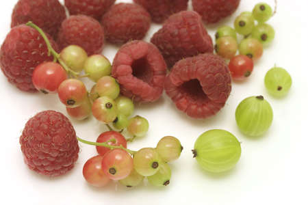 Raspberries and gooseberries isolated on white