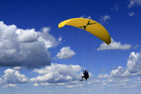 paragliding in a deep blue sky Stock Photo