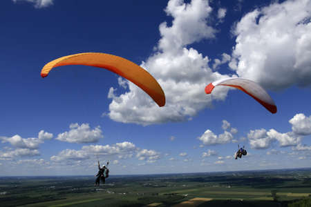 Tandem paragliders on a sunny day Stock Photo