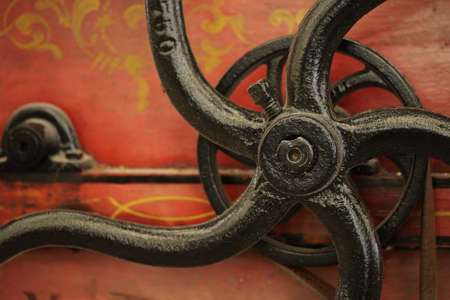 Close-up of an old machine handle photo