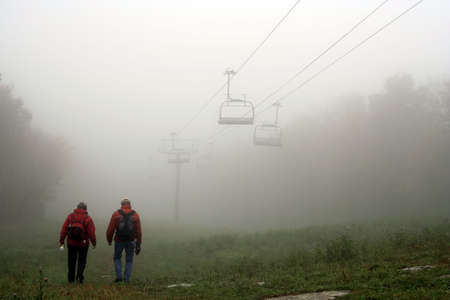 rainwear: Fall fog in the mountains - Mont Sutton, Quebec, Canada Stock Photo