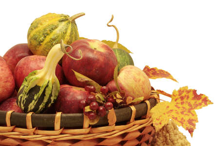 gourds: Fall basket filled with pumpkins,gourds,apples, isolated on white background Stock Photo