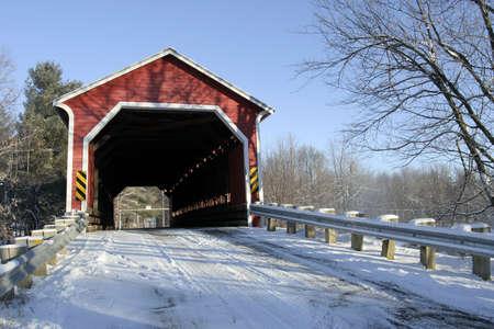 winter road: Covered bridge near Brigham, Quebec, Canada