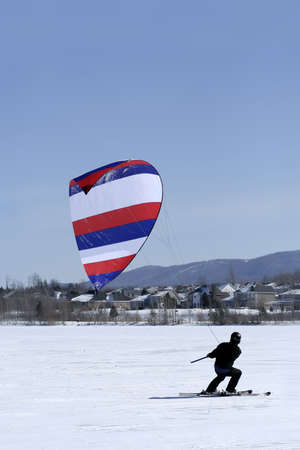Ski kiting on a frozen lake
