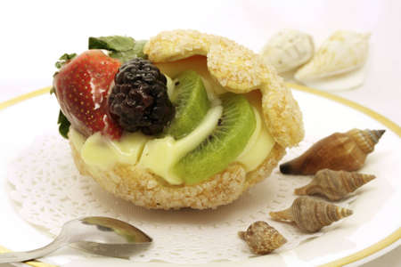 Fanciful shell cake, stuffed with custard and fruits