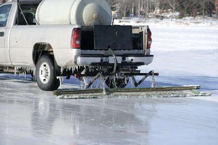 resurfacing: ice resurfacing truck working at the outdoor ice rink Stock Photo