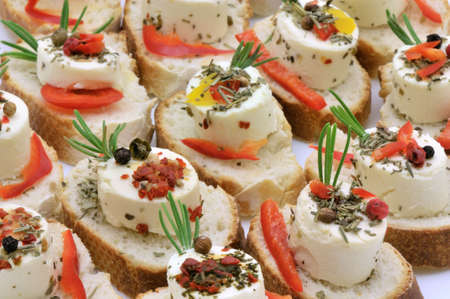 Small party cheese canapes with mediterranean flavors
