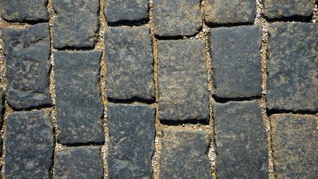empedrado: carretera pavimentada con espacios entre