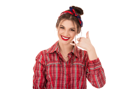 Give me a call. Closeup portrait woman excited happy student making showing call me gesture sign with hand shaped like phone on pure white background. Positive emotion face expression, retro hairtyle