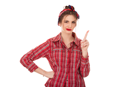 woman gesturing a no sign. Portrait unhappy, serious pinup retro style girl raising finger up saying oh no you did not do that on pure white background. Negative emotions, face expressions, feelings