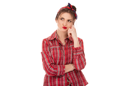 Latin American woman thinking in looking pensive and skeptical in casual clothes red checkered shirt looking to the side up isolated on white background Stockfoto