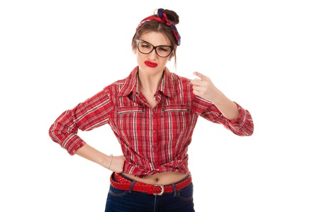 Angry upset woman raise hand pointing finger to you camera isolated on pure white background. Closeup cutout portrait of a beautiful pinup latina Caucasian girl wearing red checkered buttoned shirt