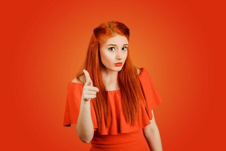 It is you, I choose you concept. Attractive woman pointing her finger at you camera with hand gesture isolated on red background Banco de Imagens