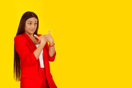 Closeup portrait of angry, unhappy, annoyed young woman, getting mad, asking question you talking to me, you mean me? Isolated on yellow background. Negative human emotions, face expression