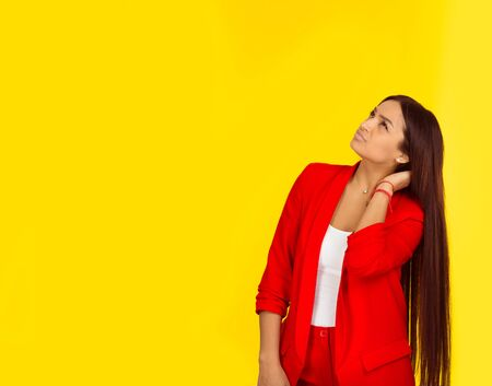 Portrait closeup funny confused skeptical woman girl female thinking with memory loss looking up isolated on yellow background with copy space. Horizontal image. Multicultural girl, Natural, no makeup Archivio Fotografico