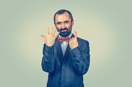 Bearded man show six fingers gesture with hands isolated green yellow wall background. Face expression, feeling, symbol, body language, non-verbal communication. Marketing, number, count, order, price