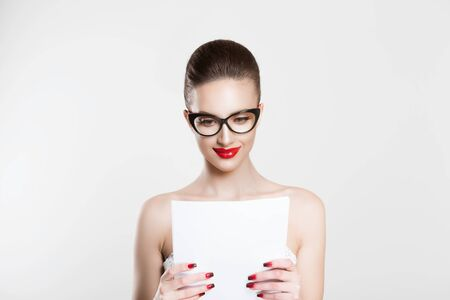 Actress learning role lines bride reading vow marital wedding contract bridal speech Beautiful happy brunette girl business woman with glasses white light grey background looking at document papers Stockfoto