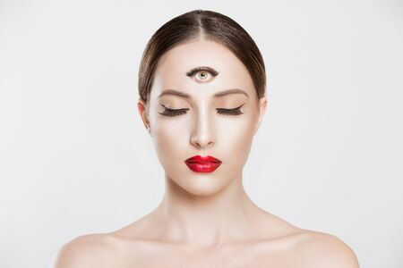 Psychic. Woman with 3 third eye looking at you camera concentrating thinking with mind and heart intuition about problem isolated white grey background. Making smart decision find solution concept