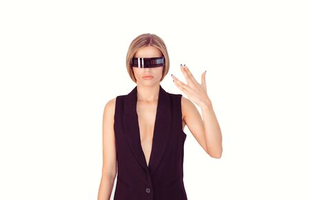 Pretty cyborg woman standing and giving a space salute hand gesture on white background.