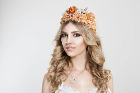 Beauty crowned queen girl woman actress miss bride looking at you camera interested pensive isolated white background. Full makeup diamond silver pink crystals crown pastel colors curly blonde hair