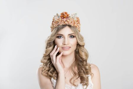 Beautiful and happy. Beauty crowned queen girl woman actress miss bride to be hand on face smiling looking at you camera isolated white background wall. Full makeup, diamond silver pink crystals crown