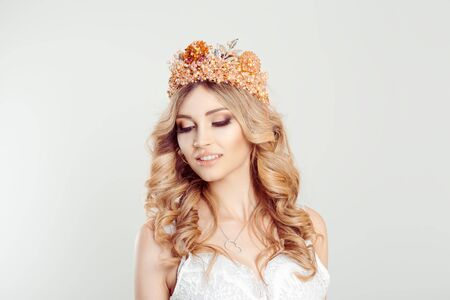 Beauty crowned queen girl woman actress miss bride eyes closed looking down shy smiling perfect with teeth isolated white background wall. Full makeup, diamond silver pink crystals crown pastel colors 免版税图像 - 139602730