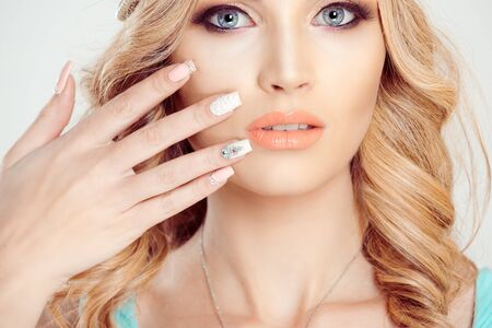 Beauty crowned queen girl woman actress miss bride to be showing her manicure art gel looking at you camera isolated white background wall. Full makeup diamond golden pink crystals nails pastel colors Imagens