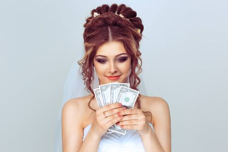 Woman with money. Greedy bride couting her earning wedding gifts